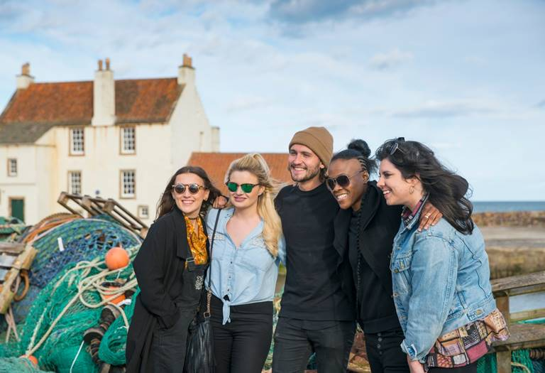 Young travellers at Pittenweem Harbour. Location shoot with Channel 4 and VisitScotland in an interactive campaign for E4. Credit Visit Scotlanbd/Kenny Lam