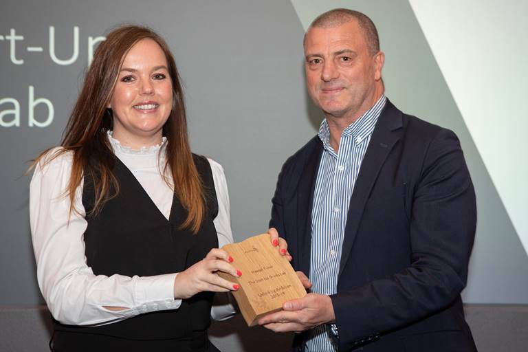 Unlocking Ambition entrepreneur Hannah Fisher, Founder of The Start-Up Drinks Lab receiving an award from Steve Dunlop, Chief Executive of Scottish Enterprise.